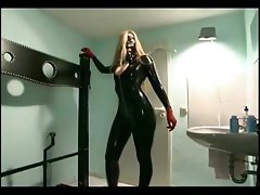 Blonde slave girl looking hot in latex