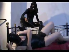 Hot dominatrix whipping her slave