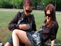 WAM clothed lesbos get messy outside