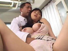 Doctor fingers her busty Japanese patient