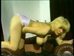 Big boobs retro girl shakes them for your pleasure