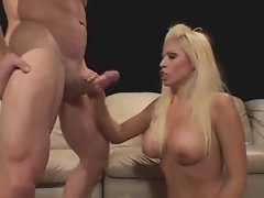 Busty blonde Dakota Cameron gives a handjob