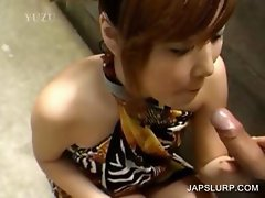 Asian slut gives blowjob outdoor
