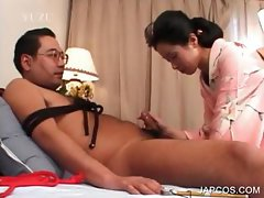 Asian geisha giving blowjob to tied up guy