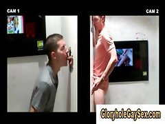 Gay gloryhole cock session at the videostore gets going