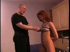 Clamps on her nipples are painful