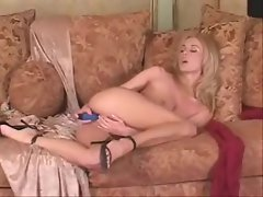 She strips from lace and toys her pussy