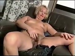 Curvy mature strips to nothing to show hairy pussy
