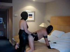 Strapon mistress fucks him in a hotel room