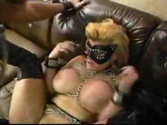 Guy and girl in kinky leather are fucking