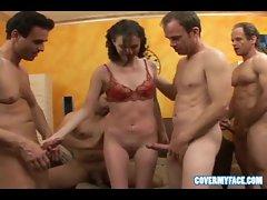 Sexy gal sucking on many cocks