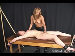 Hot girl is tied to the table and her pussy is fingered