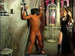 She beats his tied up cock hard