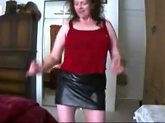 Mature brunette in a black leather mini skirt 2
