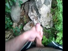 Jerking off behind trees after feel girls ass on underground