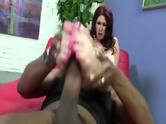 Interracial fetish hottie gives footjob