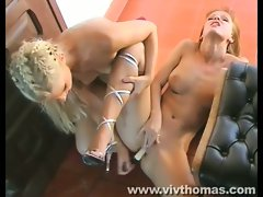 Hot lesbians licking pussy and toying in the doorway