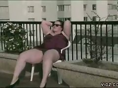 Fatso bitch showing her hot fat body on the balcony