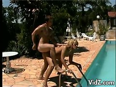 Young tranny drilled hard by the pool