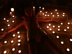 Busty girl surrounded by candles and get hot waxed