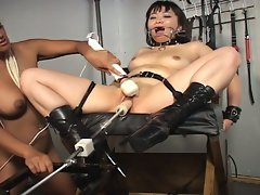 Sex slaves in bondage meet the fuck machine