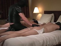 Masked master spanks and fucks slaves