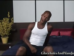 White guy gives black dick a handjob