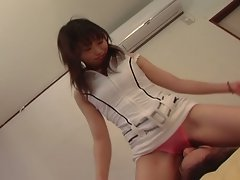 Japanese gal stays dressed but sits on his face while he jacks off