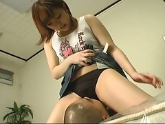 Dressed japanese girl rubs her crotch in his face while he jerks off