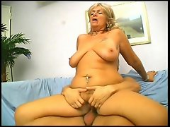 Karola is one filthy mature blonde bitch who loves getting her holes...
