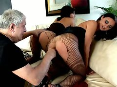 Brunette Russian whores Ravenna And Beatrice sucking two giant cocks...