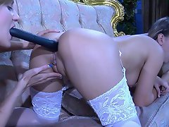 Dressy babes in retro style lingerie share one toy poking and probing...