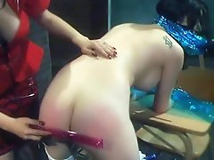 Soma dons her fierce red dominatrix outfit and subjects her sexy...
