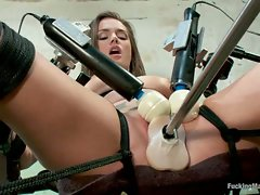 Tori Black tied down and machine fucked with a power tool. She is...