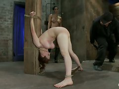 Big titted 19yr old is bound strappado to a beam & double penetrated....
