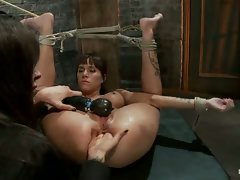 Gia DiMarco is bound hard in rope bondage, and made to squirt like a...