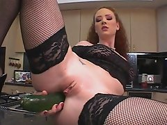 Right in the kitchen, this wild whore, Audrey Hollander, strips...