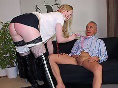 A young, blonde girl in miniskirt and knee high boots enters the room...