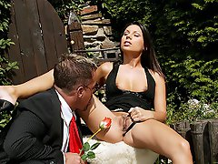 A guy and a girl are in the garden. He lifts her dress up and starts...