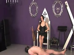 Sexy domina rules over her hooded sub