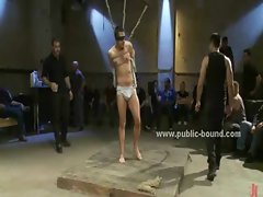 Kinky gay boy in ropes kneels down