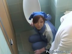 Asian toilet attendant cleans wrong