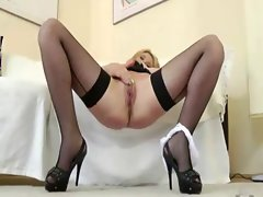 Busty blonde handeling a mature cock