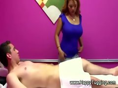 Busty masseuse gets his hard dick in her hands during his massage