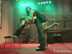 Mad domina punishing her slave at the sex show