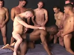Black dude grinded bareback by nine men in a attractive bukkake.