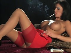 Lewd Sexual Top heavy Dark haired In Heels Smoking and Playing
