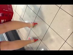 Filthy bitch in Supermarket with Heels and Skirt