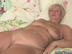 Buxom granny gets her older muff fingered by photographer
